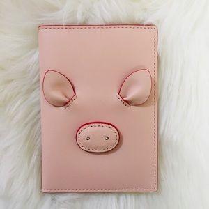 Kate Spade piggy passport holder